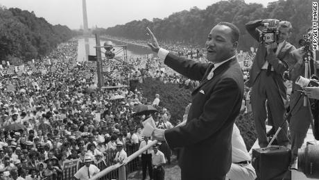King waves to supporters during the 1963 March on Washington.