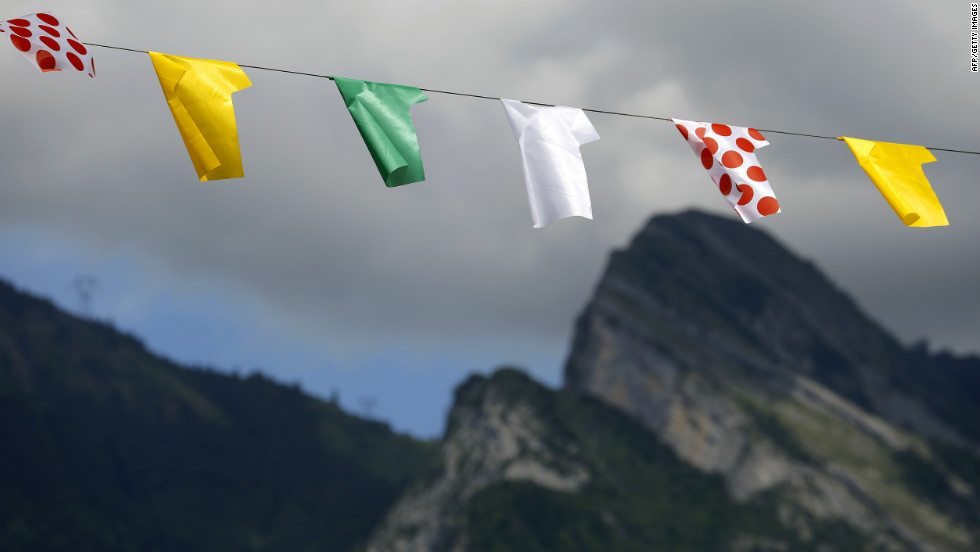 Representations of Tour de France leaders' jerseys hang along the road during Thursday's race.