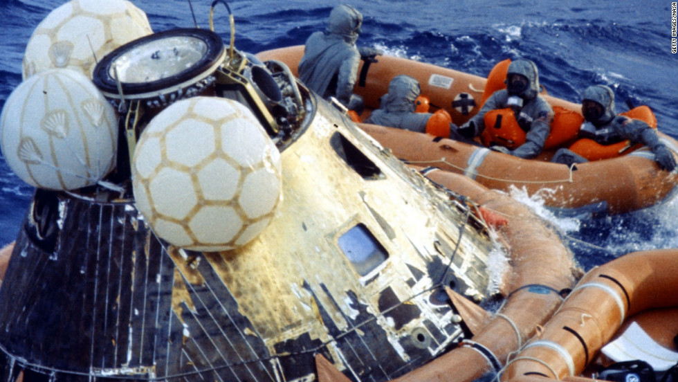 After the capsule was stabilized, the astronauts and SEALs put on biological isolation garments to guard against possible lunar pathogens. If the SEALs had been been directly exposed to the astronauts, they would have been ordered to be quarantined.