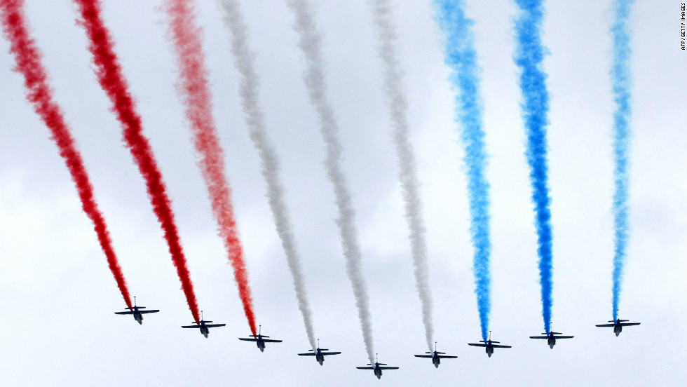 The Patrouille de France military planes fly over the Champs Elysee avenue in Paris to open the Bastille Day military parade.