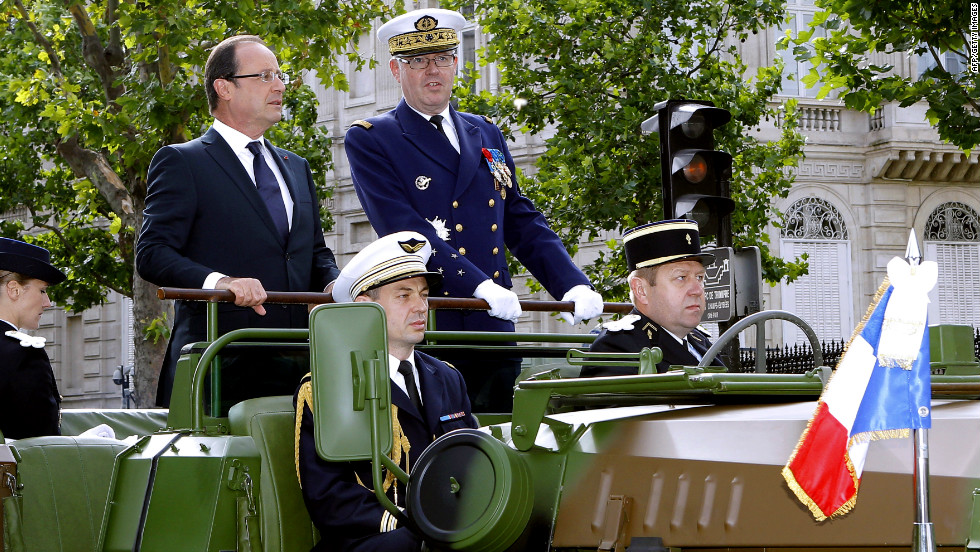 France's President Francois Hollande (left) and French Army Chief of Staff Admiral Edouard Guillaud review the troops.