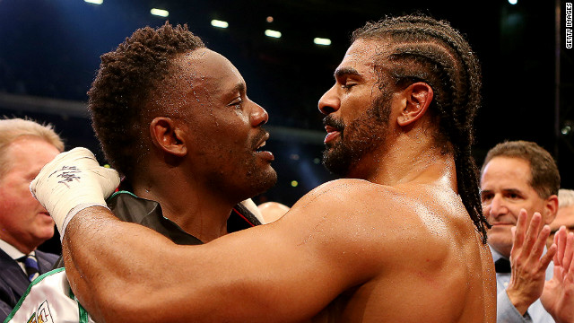 Best of friends? Dereck Chisora (left) and David Haye embrace after the grudge match at Upton Park in London