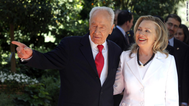 Israeli President Shimon Peres, left, welcomes U.S. Secretary of State Hillary Clinton before their meeting on July 16, 2012.