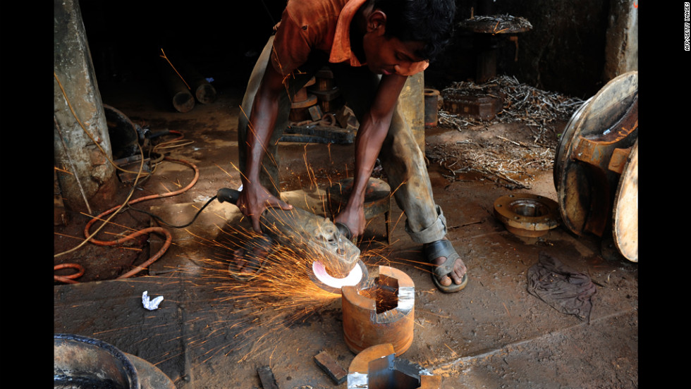A Bangladeshi laborer works in a casting factory at a dockyard beside the Buriganga River in Dhaka on Monday.