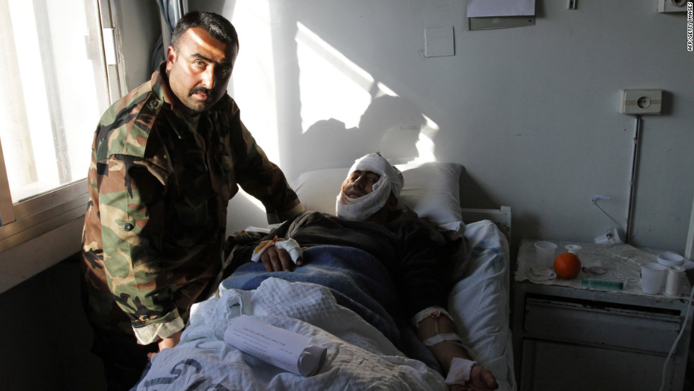 A Syrian man who was wounded in a suicide attack rests at a hospital in Damascus on December 23, 2011. Suicide bombers hit two security service bases in the Syrian capital, killing dozens of people.