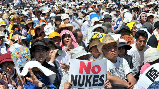 People hold placards to protest against nuclear power plants in Tokyo on July 16, 2012. Tens of thousands of people rallied in Tokyo demanding an end to nuclear power, the latest in a series of anti-atomic gatherings following the tsunami-sparked disaster at Fukushima. AFP PHOTO / Yoshikazu TSUNO (Photo credit should read YOSHIKAZU TSUNO/AFP/GettyImages)