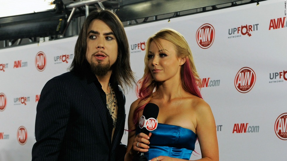 Many adult film actors are using Twitter to develop a mainstream fan base, including actress Kayden Kross, pictured here with rocker Dave Navarro at an adult video awards show earlier this year.  Kross is currently working on a novel and tweets her essays out to her followers.