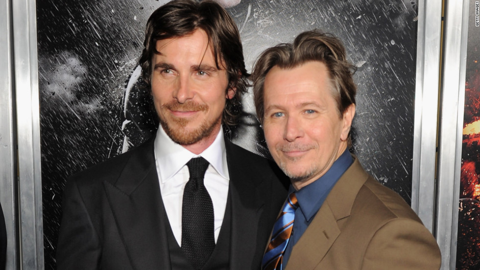 "Christian Bale and Gary Oldman pose for pictures at the New York premiere of ""The Dark Knight Rises."""