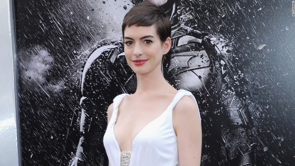"Anne Hathaway dons white for the New York premiere of ""The Dark Knight Rises."""
