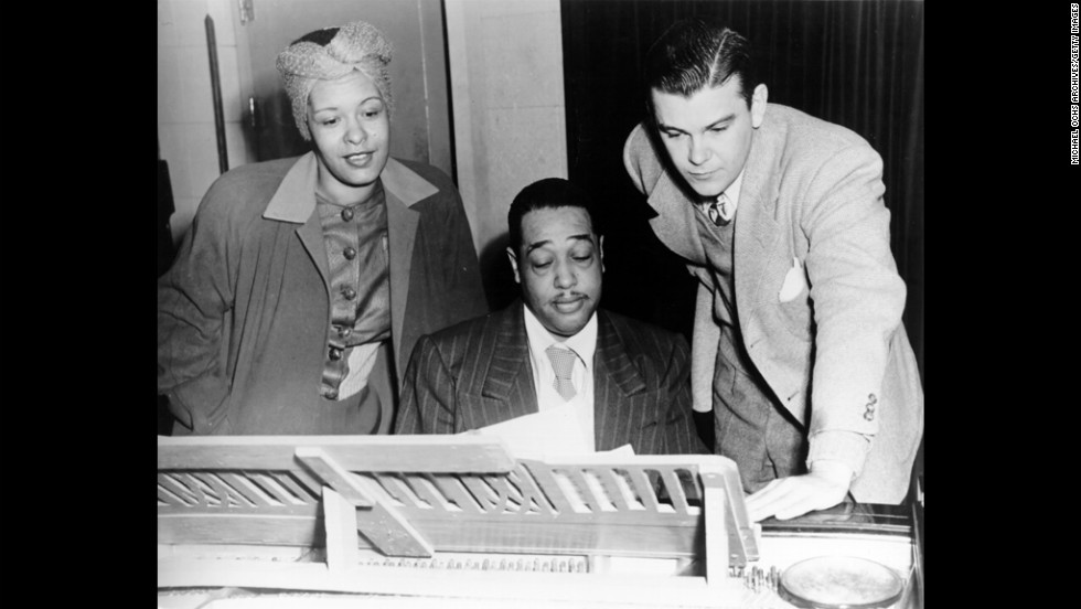 "Jazz singer Billie Holiday, left, and composer Duke Ellington, center, rehearse ""Symphony in Black: A Rhapsody of Negro Life"" in 1935. Fans and artists are celebrating Lady Day, as she was known, on the 100th anniversary of her birth on April 7, 1915."