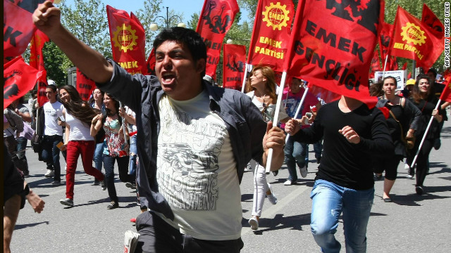 Activists run during May Day protests in Ankara on May 1, 2012. Fed up with high unemployment and austerity, May Day protesters took to the streets across Europe today in a wave of anger that threatens to topple leaders in Paris and Athens. AFP PHOTO/ADEM ALTAN (Photo credit should read ADEM ALTAN/AFP/GettyImages)