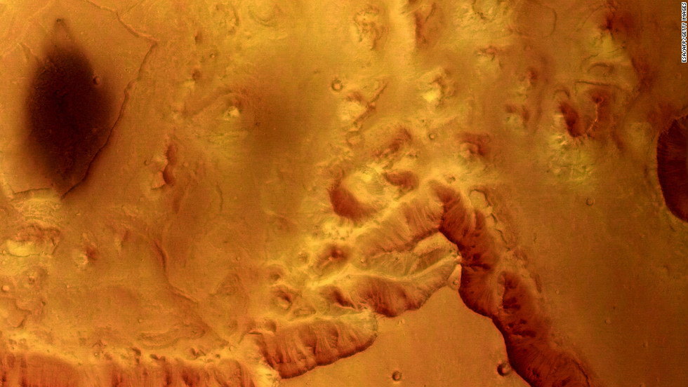 The European Space Agency's Mars Express captured this view of Valles Marineris in 2004. The area shows mesas and cliffs as well as features that indicate erosion from flowing water.