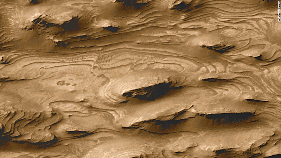 A photo captured by NASA's Mars Global Surveyor in 2000 offers evidence that the planet may have been a land of lakes in its earliest period, with layers of Earth-like sedimentary rock that could harbor the fossils of any ancient Martian life.