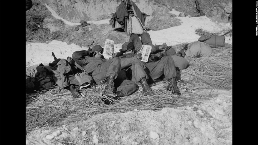 In 1951, American soldiers read comic books during the Korean War.