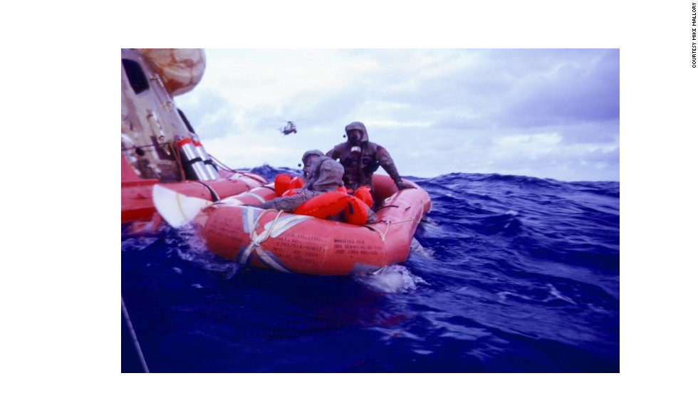 "In the ""decontamination raft"" mission leader Clancy Hatleberg sprayed the astronauts with sodium hypochlorite and helped them scrub their suits."