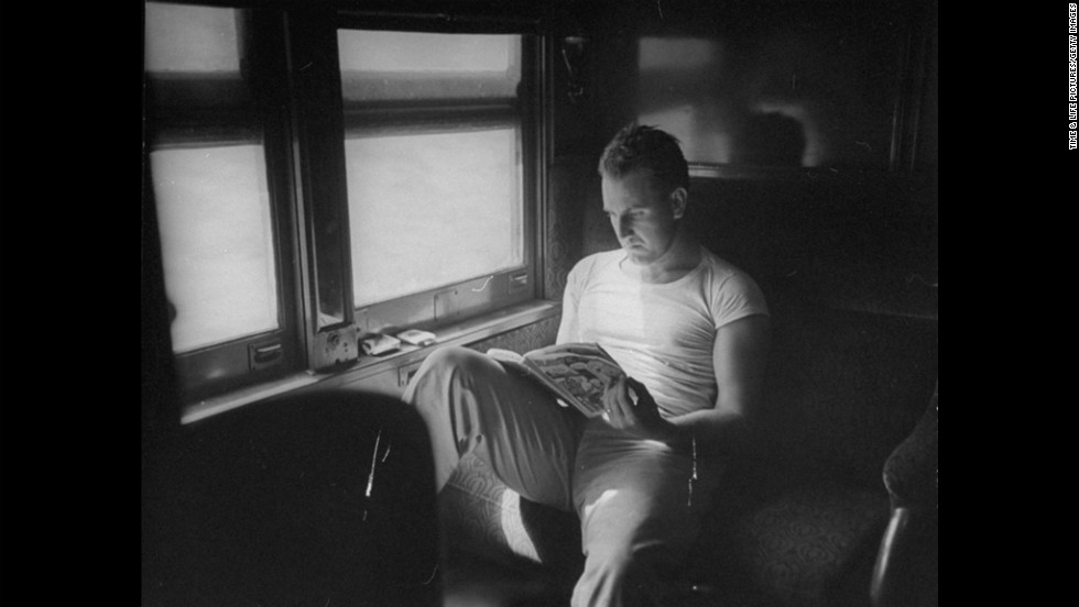 "A man reads a comic book on a Pullman car in 1945. <a href=""http://life.time.com/culture/pictures-of-people-reading-comics/#1"" target=""_blank"">Click here to see more photos from Life.com.</a>"