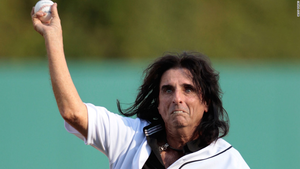 Alice Cooper throws the first pitch at Detroit's Comerica Park.