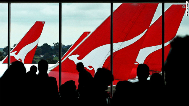 Passengers wait to board their Qantas flights at Melbourne Airport on October 31, 2011.