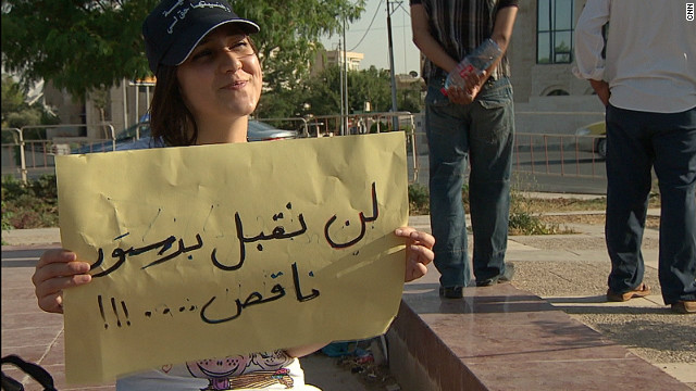 "Rola Habashna, 17, is denied Jordanian citizenship despite having been born and bred in the country, because her father is Moroccan. She is protesting for her citizenship rights with a sign that reads: ""We will not accept half a constitution."""