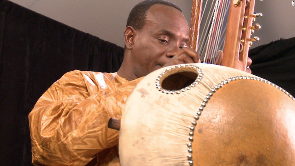 Diabate was born in Bamako, the capital of Mali, in 1965. He plays the kora, a 21-string harp-like instrument from West Africa.