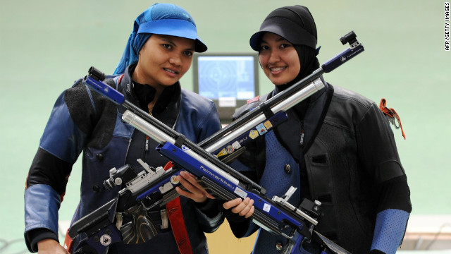 File photo of Nur Suryani Mohamed Taibi, left, at the 2010 Commonwealth Games in New Delhi on October 10, 2010.