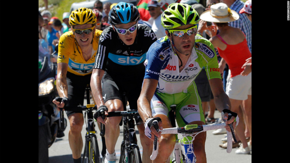 Bradley Wiggins, left, is in first place while Christopher Froome is in second and Vincenzo Nibali is in third place in the race to maintain their standings Wednesday.