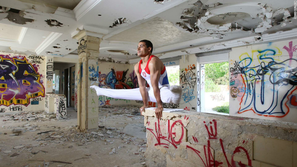 In 2009 the Tunisian gymnast Wajdi Bouallegue was banned by the government from competing internationally. His crime was to tear up a picture of the now deposed leader Zine al Abidine Ben Ali. Here he is pictured in the shell of the former home of Ben Ali's brother-in-law.