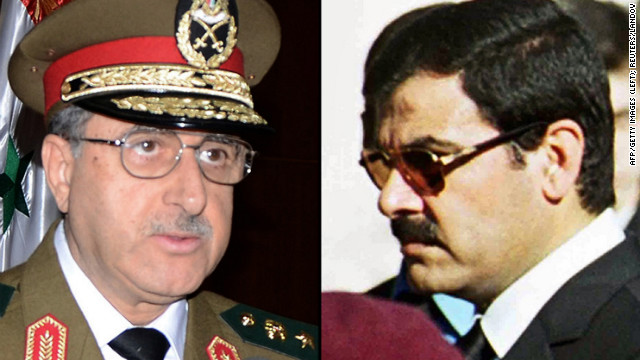 Syrian Defense Minister Dawood Rajiha, left, and Assef Shawkat, right, the brother-in-law of President Bashar al-Assad.