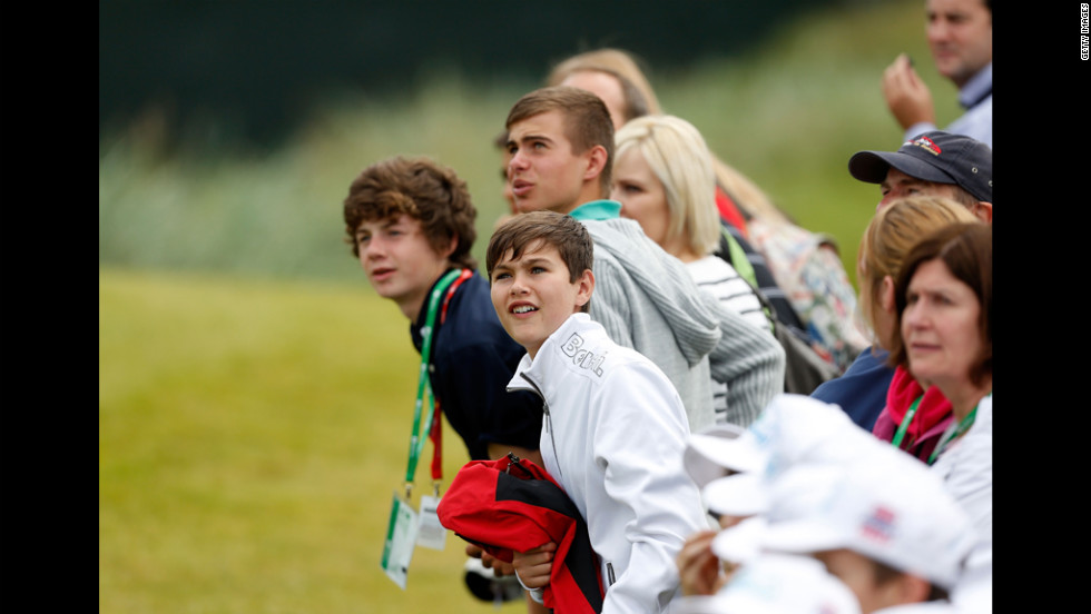 Junior spectators take in the action during the first round Thursday.