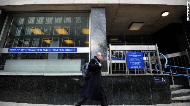 A man walks past Westminster Magistrates Court in central London. Four people appeared in court today on terror charges.