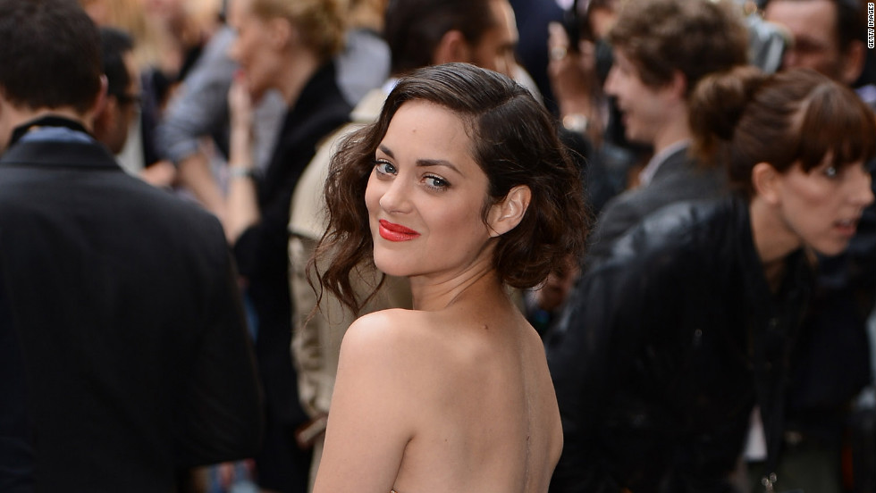 "Marion Cotillard attends the London premiere of ""The Dark Knight Rises."""