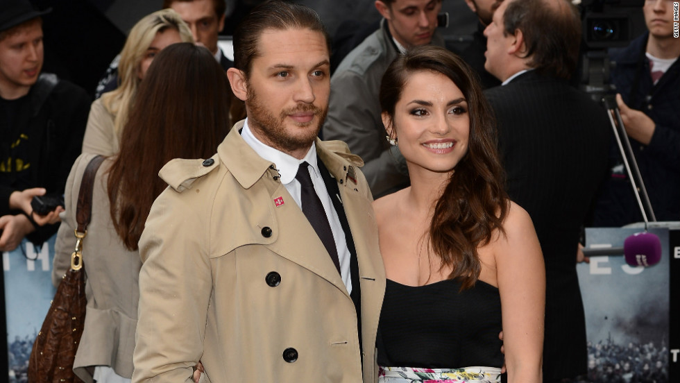 "Tom Hardy and Charlotte Riley attend a premiere of ""The Dark Knight Rises"" in London."