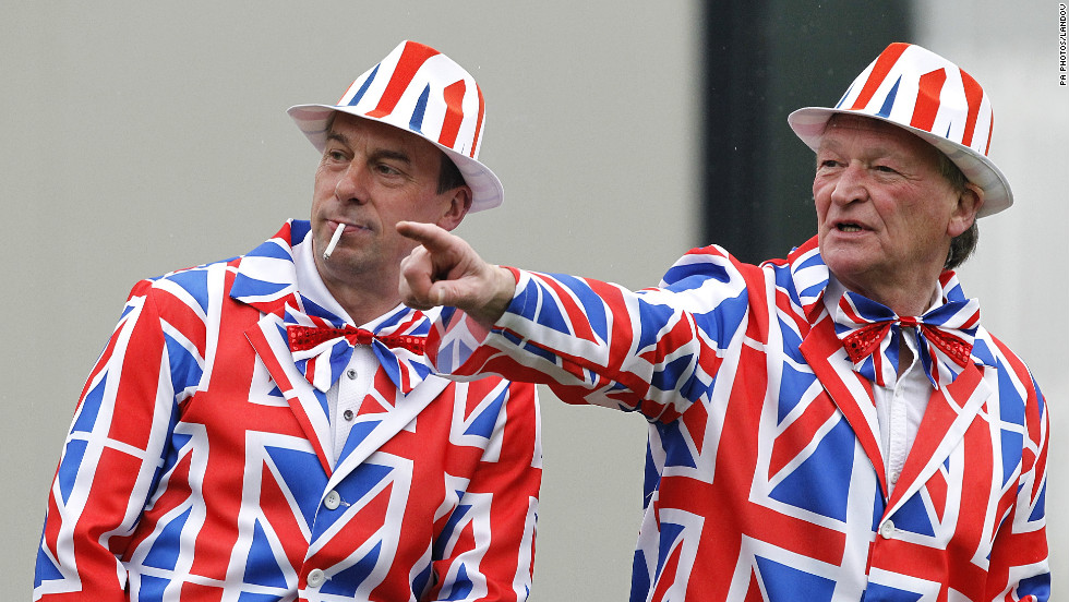 Golf fans don matching Union Jack suits for early action Thursday, the first day of the British Open.