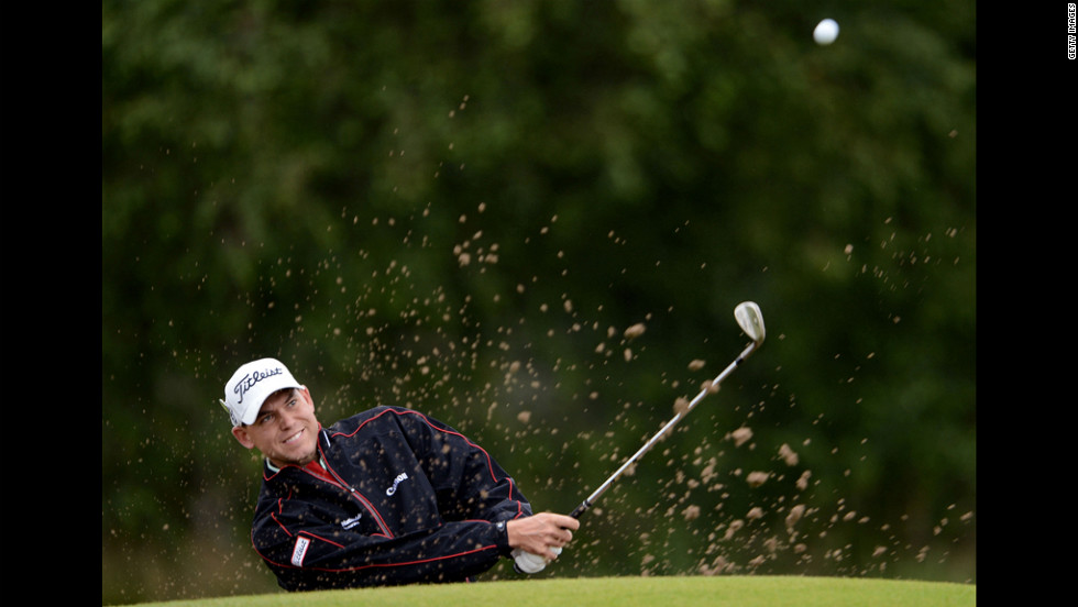Bill Haas of the United States plays a shot from a bunker Thursday.