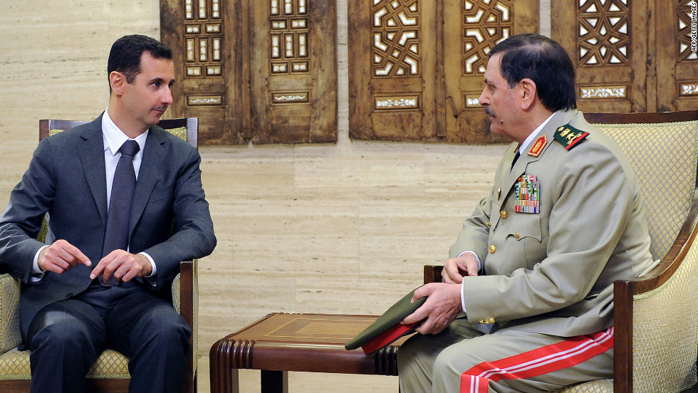 A picture released by the official Syrian Arab News Agency on July 19 shows Syrian General Fahd al-Freij meeting with President Bashar al-Assad in Damascus after his swearing-in ceremony as defense minister.