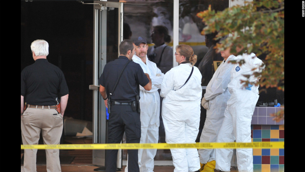 Investigators were a common sight at the theater on July 20, 2012.