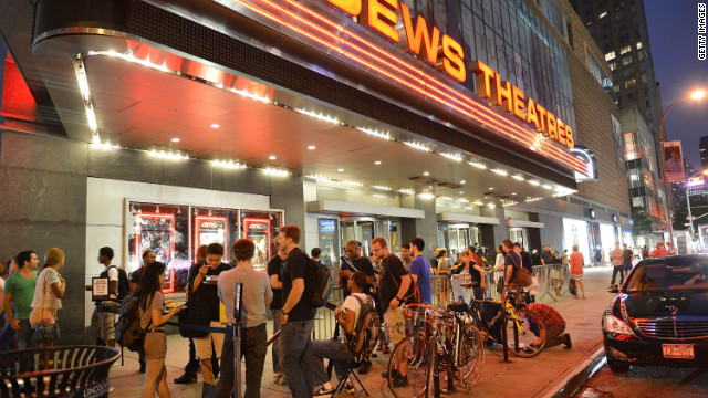 "Fans wait outside for ""The Dark Knight Rises"" midnight premiere in New York."
