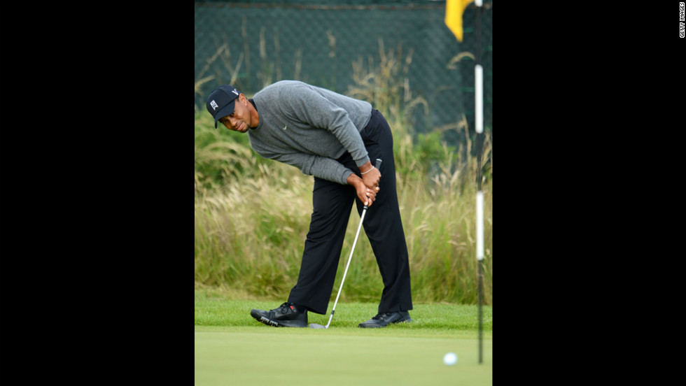 Woods intently watches his chip shot on the 14th hole during the second round.