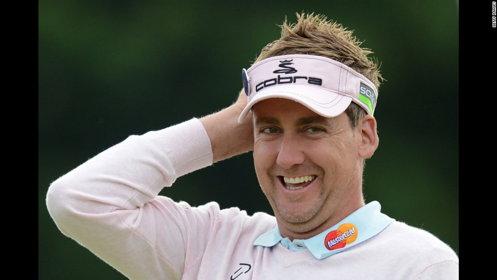England's Ian Poulter walks off the 18th green during the second round on Friday.