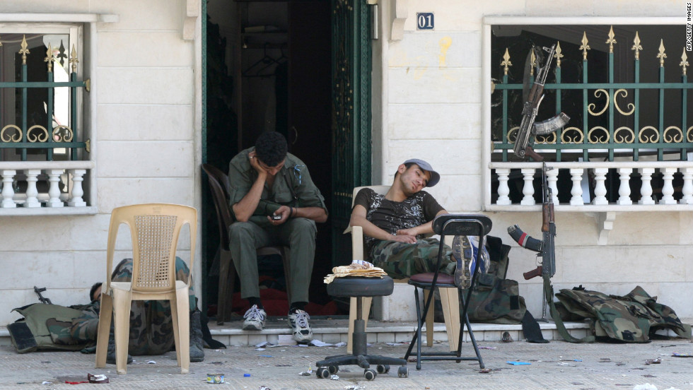 Members of Syria security forces rest in the al-Midan area in Damascus on Friday.