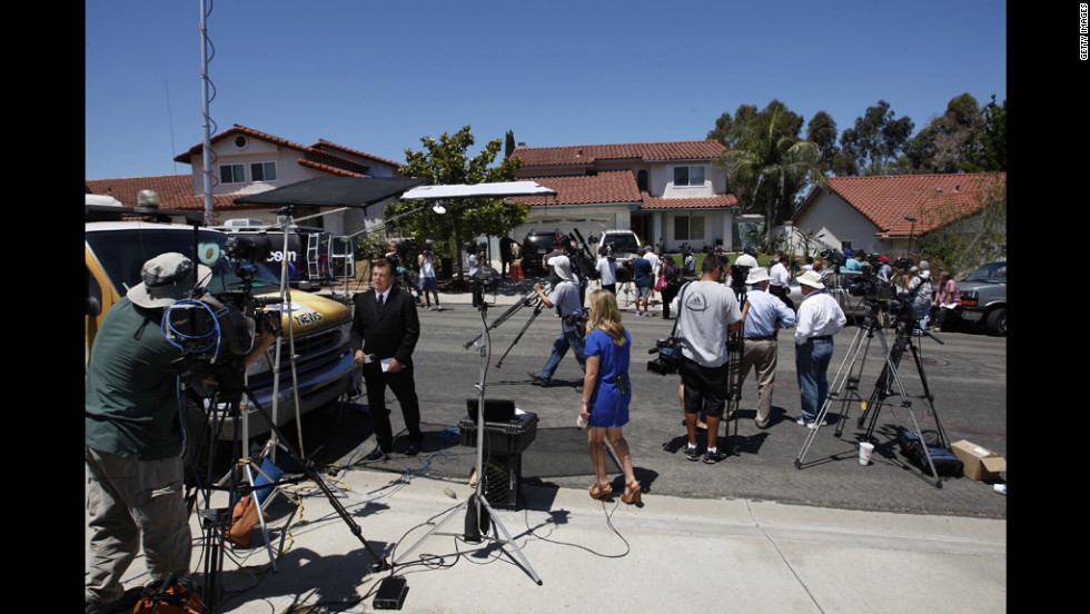 Television news crews gather in front of the home of Robert and Arlene Holmes, parents of suspect James Holmes, in San Diego on July 21, 2012.