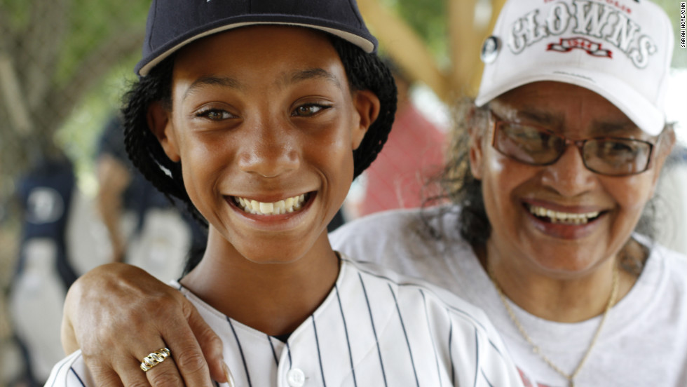 "Along their cross-country journey, Philadelphia's Anderson Monarchs played games against local youth teams, visited historic sites and met surviving Negro League players. Here, Mamie ""Peanut"" Johnson, right, the only female pitcher in the Negro Leagues, meets her 21st century counterpart, Mo'ne Davis, 11."