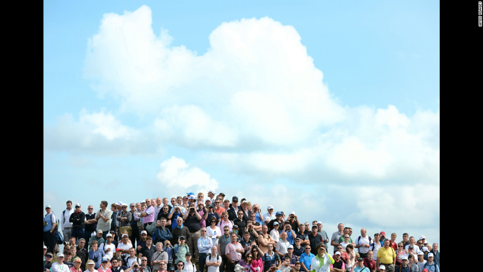 Spectators at the Open Championship enjoy Saturday's play in ideal golf weather.