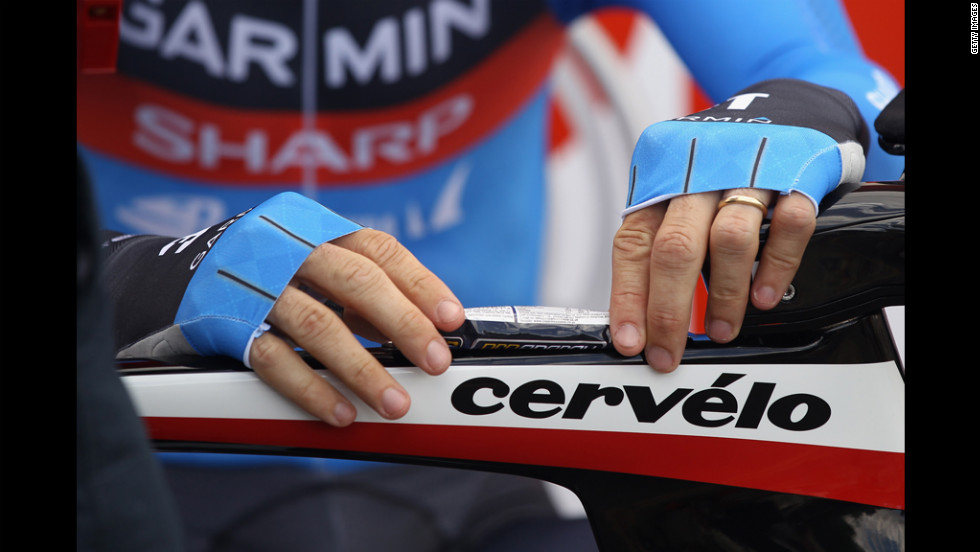 Briton David Millar tapes an energy gel to his top tube Saturday before stage 19.