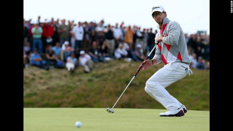 Adam Scott of Australia reacts to his putt on the sixth hole on Saturday.
