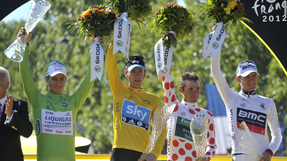 From left, best sprinter Peter Sagan of Slovakia, overall race winner Bradley Wiggins of Great Britain, best climber Thomas Voeckler of France and best young rider Tejay Van Garderen of the United States celebrate on the podium after finishing the final stage of the Tour de France in Paris on Sunday.