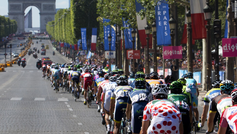 The pack of cyclists rides toward the Arc de Triomphe on the Champs-Elysees in Paris on Sunday.