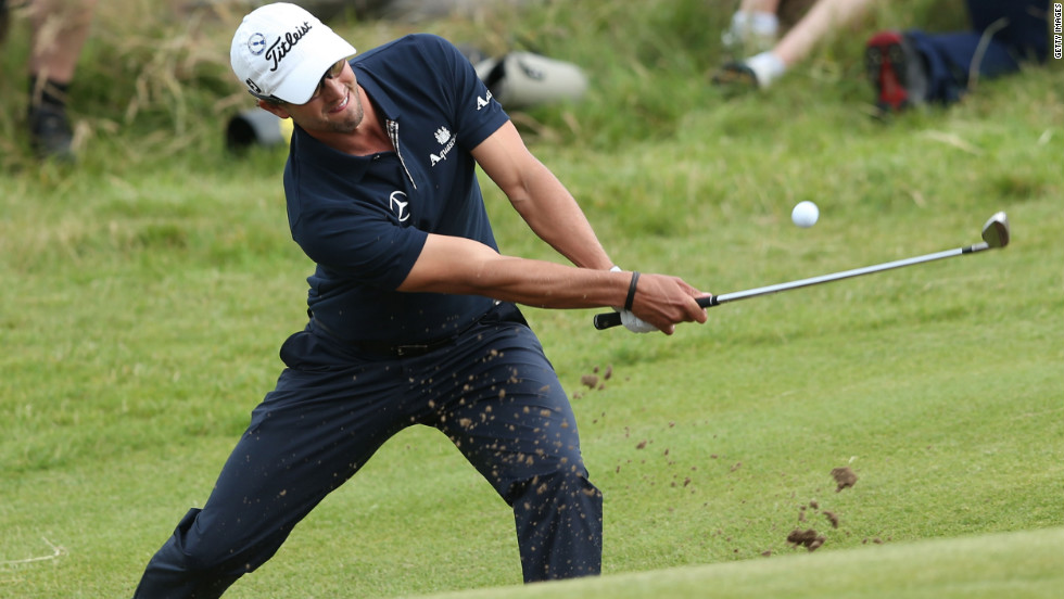 Adam Scott plays a bunker shot on the 15th hole Sunday.