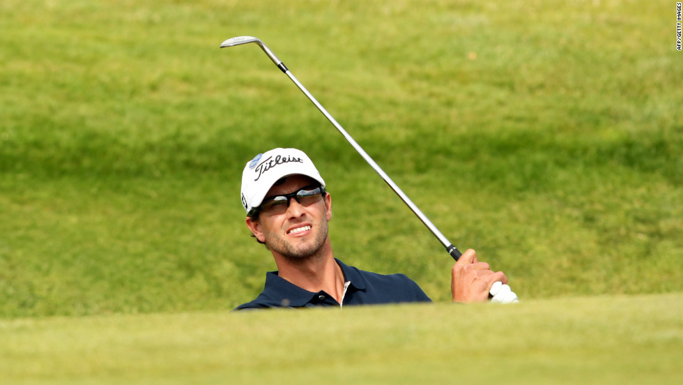 Adam Scott plays out of a bunker on Sunday.