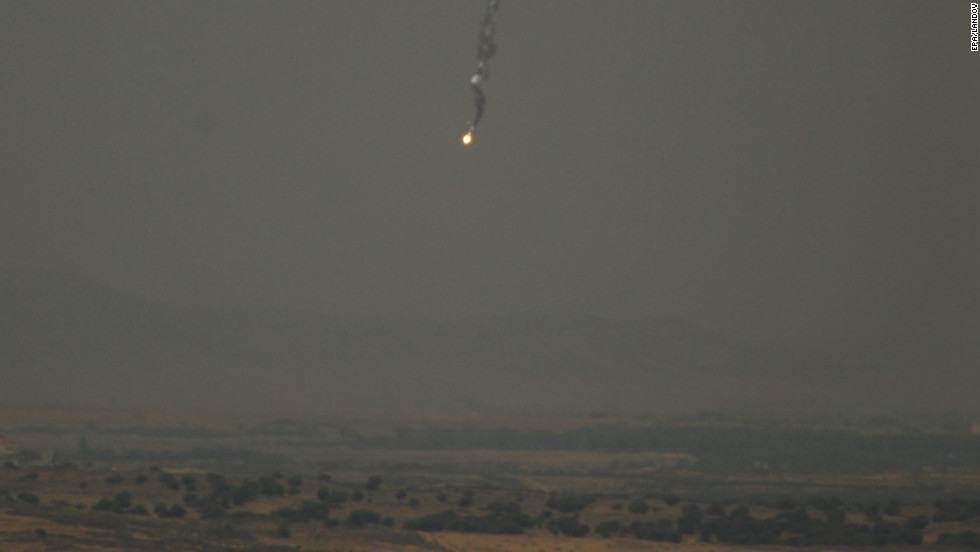 A mortar shell falls toward the Syrian village of Jbatha Al-khashab, about 45 kilometers (28 miles) south of Damascus. It's seen from the Israeli side of the border, in the Golan Heights.